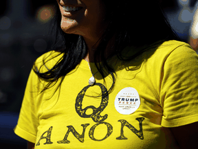 A supporter of U.S. President Donald Trump wears a QAnon shirt in Adairsville, Georgia, September 5, 2020.