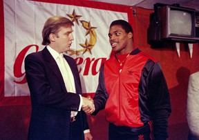 In a photo from March 8, 1984, Donald Trump, then owner of the New Jersey Generals, shakes hands with Herschel Walker in New York after Walker agreed to a four-year contract with the USFL football team.
