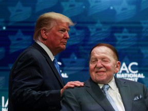 U.S. President Donald Trump greets Sheldon Adelson while taking the stage at the Israeli American Council National Summit in Hollywood, Florida, U.S., December 7, 2019.