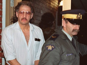 Allan Legere departs from court in Burton, New Brunswick, as he waits for jurors in his murder trial to return a verdict in Burton, N.B. on Nov. 2, 1991.