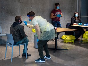 A swab is taken at a pop-up COVID-19 testing site on the Dalhousie University campus in Halifax on Wednesday, Nov. 25, 2020.