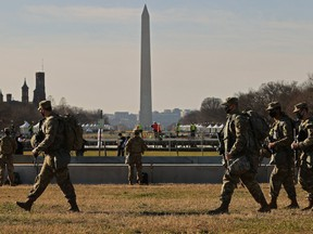 National Guard troops move along the National Mall the day after the House of Representatives voted to impeach President Donald Trump for the second time January 14, 2021 in Washington, DC.