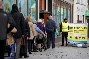 People queue to receive the coronavirus disease (COVID-19) vaccine outside a closed down Debenhams store that is being used as a vaccination centre in Folkestone, Kent, Britain January 28, 2021.