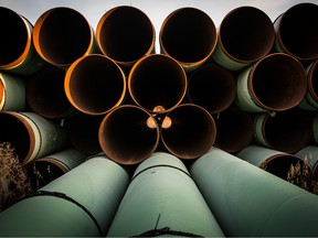 Miles of unused pipe, prepared for the Keystone XL pipeline, sit in a lot on October 14, 2014 outside Gascoyne, North Dakota.