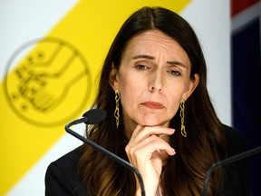 Prime Minister Jacinda Ardern listens to reporters' questions on February 14, 2021 in Wellington, New Zealand.