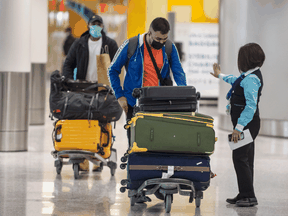 Travellers arriving at Pearson International Airport are guided to their COVID-19 quarantine hotel, Wednesday February 24, 2021.