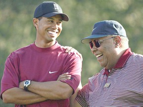 Tiger Woods and his father, Earl, smile after he won the Target World Challenge on December 12, 2004 at Sherwood Country Club in Thousand Oaks, California.