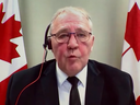 Appearing by remote uplink, Public Safety Minister Bill Blair defends the details of a new gun buyback strategy on February 16, 2021.