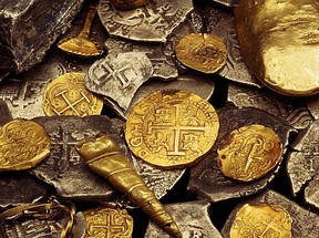 Some of the coins and gold raised from the wreck of the Whydah.