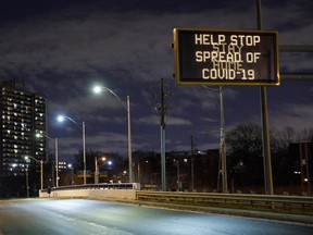 A highway sign encouraging people to stay home in Toronto, Ontario, Canada, on Monday, Nov. 23, 2020.