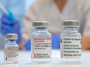 Used vaccine vials that contained (L-R) Pfizer-BioNTech, Moderna and AstraZeneca Covid-19 vaccines are pictured at the Skane University Hospital vaccination centre in Malmo, Sweden, on February 17, 2021.