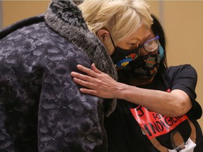 Heather Bear, Vice-Chief of the FSIN, hugs Debbie Baptiste, Colten Boushie's mother, during a news conference following the release of a report by the RCMP Public Complaints Commission that examined how officers handled the investigation into Boushie's death.