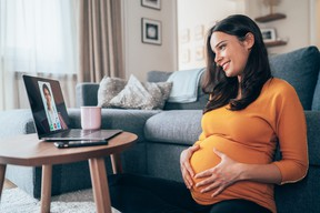 Pregnant woman having Video call with doctor