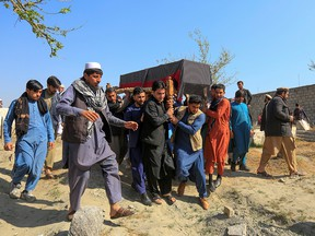 Afghan men carry the coffin of one of three female media workers who were shot and killed by unknown gunmen, in Jalalabad, Afghanistan, on March 3, 2021. The Taliban has embarked upon a campaign of targeted assassinations that has left hundreds of people dead, mostly judges, journalists, women's rights leaders and civil society figures, writes Terry Glavin.
