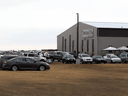 Cars parked outside Gracelife Church near Edmonton on Sunday, March 28, 2021 as Pastor James Coates returns after spending 33 days in jail for disobeying public health orders.