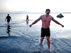 Adam Kreek (centre), Fraser Thomson and Patrick Walter exit the water at Mt. Douglas Park in Victoria on March 26.