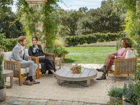 This undated image released March 7, 2021 courtesy of Harpo Productions shows Britain's Prince Harry (L) and his wife Meghan (C), Duchess of Sussex, in a conversation with US television host Oprah Winfrey.