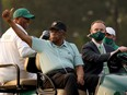 Lee Elder, centre, waves to the crowd after the opening ceremony of the Masters at Augusta National Golf Club in Augusta, Ga., on April 8.
