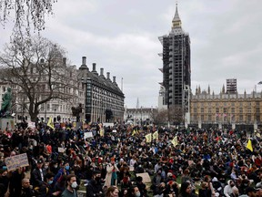 Protestors hold placards during a 'Kill The Bill' protest against the Government's Police, Crime, Sentencing and Courts Bill, in Parliament Square, central London on April 3