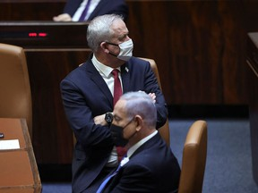Israeli Prime Minister Benjamin Netanyahu (R) and Defense Minister Benny Gantz attend the swearing-in ceremony of Israel's Knesset (parliament) in Jerusalem, on April 6, 2021.