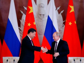 Russian President Vladimir Putin, right, and his Chinese counterpart Xi Jinping shake hands in Moscow in 2019.