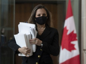 Finance Minister Chrystia Freeland walks to a news conference in Ottawa, on April 19, before delivering the government's first budget since the COVID-19 pandemic began.