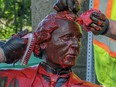Workers remove red paint from the John A. Macdonald statue in Charlottetown on Friday June 19, 2020.