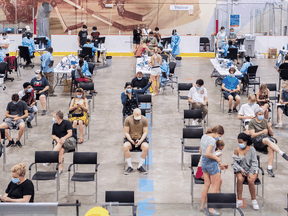 People at the Bill Durnan Arena COVID-19 vaccination site in Montreal, Saturday, May 22, 2021.