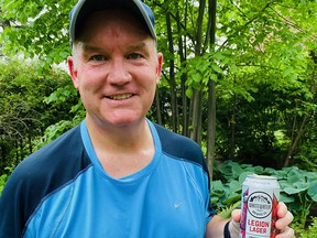 """Twitter exploded when Conservative Party leader Erin O'Toole tweeted this photo of himself on May 21, with the caption: """"Starting the long weekend off right. Rebecca had a cold one waiting for me after my run. Wishing everyone a safe and relaxing long weekend."""""""