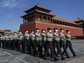 People's Liberation Army soldiers march outside the Forbidden City, near Tiananmen Square. Canada has increased participation in joint military exercises with allies in the region, including two anti-submarine warfare exercises.