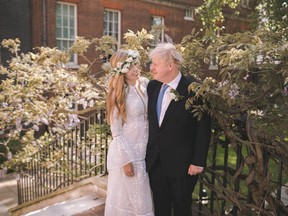 Boris and Carrie Johnson are seen in the garden of 10 Downing Street, after their wedding, in London, Britain May 29, 2021.