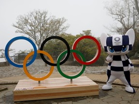 Tokyo 2020 Olympic Games mascot Miraitowa poses with a display of the Olympic symbol after an unveiling ceremony of the symbol on Mt. Takao in Hachioji, west of Tokyo, Japan, April 14, 2021.