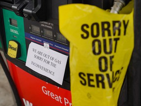 "An ""out of gas"" sign is seen at a gas station in Smyrna, Ga.,  on May 11, 2021, following the cyberattack on the Colonial Pipeline. ""Putting aside idiots believing a solar panel can replace fossil fuels, can someone tell me who didn't realize our energy infrastructure was spectacularly vulnerable,"" writes John Robson."