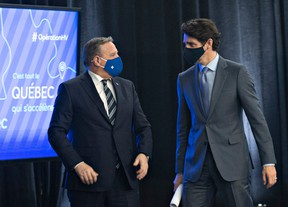 Quebec Premier Francois Legault, left and Prime Minister Justin Trudeau chat after they announced high speed internet for Quebec regions, Monday, March 22, 2021 in Trois-Rivieres Que.
