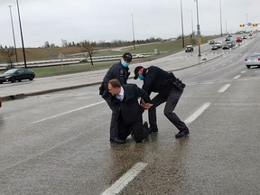 Supporters of Artur Pawlowski videotaped his arrest in Calgary on Saturday.