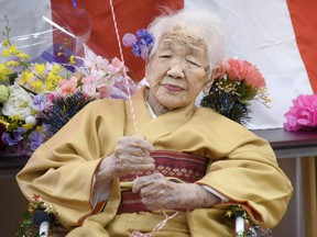 Kane Tanaka, born in 1903, smiles as a nursing home celebrates three days after her 117th birthday in Fukuoka, Japan, in this photo taken by Kyodo January 5, 2020.