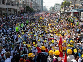 In this file photo taken on February 22, 2021, protesters take part in a demonstration against the military coup in Mandalay.
