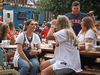 People drink and eat at Truck Yard beer garden in Houston in early April. While some Canadian provinces are struggling with lockdowns, Texas did away with most COVID restrictions in March.