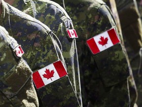In this file photo, members of the Canadian Armed Forces march during the Calgary Stampede parade in Calgary, on Friday, July 8, 2016.