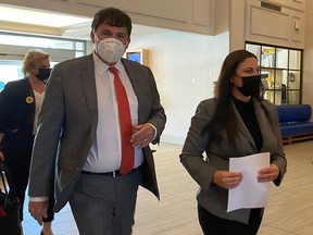 Liberal MP Dominic LeBlanc and Jenica Atwin arrive at a news conference in Fredericton on June 10, 2021, after it was announced that Atwin was leaving the Green party for the Liberals.