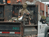 A Sir John A. MacDonald statue is trucked away after city crews removed it in Charlottetown, on Tuesday, June 1, 2021.