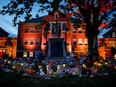 A makeshift memorial is seen outside the former Kamloops Indian Residential School, where the remains of 215 children have been discovered in unmarked and undocumented graves, on June 2, 2021.
