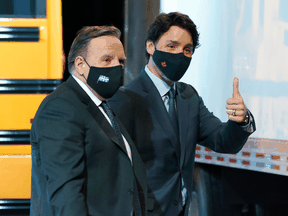 Prime Minister Justin Trudeau gives a thumbs up in March as he leaves a news conference with Quebec Premier François Legault, whose province's Bill 96 does more than chip away at minority rights, Chris Selley writes.