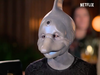 A person disguised as a dolphin in the new Netflix series Sexy Beasts.