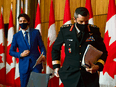 Prime Minister Justin Trudeau and Major-General Dany Fortin leave a press conference in Ottawa on Dec. 10, 2020.