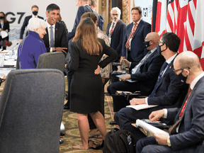 Group of Seven finance chiefs, including a barefoot Chrystia Freeland of Canada, gather this week to hammer out an agreement on corporate-tax harmonization aimed at raising revenues as economies recover from the pandemic.