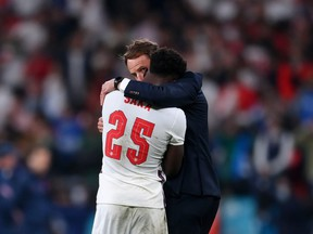 Bukayo Saka of England is consoled by Head Coach, Gareth Southgate after his penalty miss during the UEFA Euro 2020 Championship Final between Italy and England at Wembley Stadium on July 11, 2021 in London, England.
