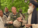 Then-Brigadier General David Fraser was escorted to a village during a visit to Afghanistan's Shah Wali Kot area in 2006.