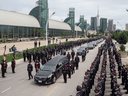 The hearse carrying the casket of Toronto Police officer Jeffrey Northrup arrives for his funeral in Toronto, on Monday July 12, 2021.