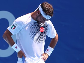 Italian tennis star Fabio Fognini blamed the searing Tokyo heat for incessant use of a homophobic slur in his Olympic men's singles loss to Daniil Medvedev Wednesday.